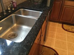 kitchen, home, home improvement, uba tuba, granite countertops, stone countertops, stone slab, nautral stone countertop, cracked countertop, cracked granite, sink countertop, sink cutout, granite crack in front of sink, sink crack, granite countertop sink, granite crack,repair, countertop, quartz, counterop repair, surface link, brand new countertops, stone slab countertops, bar top, granite repair